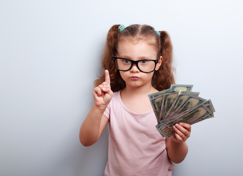 Cute kid girl holding dollars and have an idea how earning much