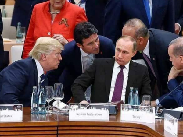 a-photo-of-trump-and-other-leaders-staring-at-putin-is-going-viral--but-its-fake